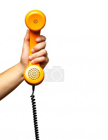 Photo for Close Up Of Hand Holding Telephone against a white background - Royalty Free Image