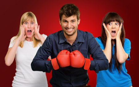 Man With Boxing Gloves And Scared Woman Standing Behind