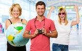 Portrait Of Happy Tourist Family