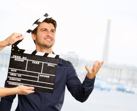 Photo for Director Clapping The Clapper Board, Outdoor - Royalty Free Image