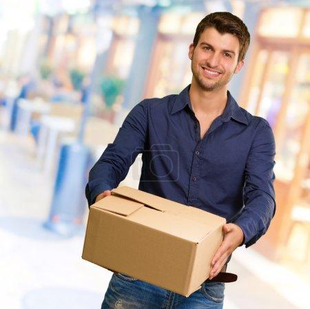Young Man Holding Cardbox