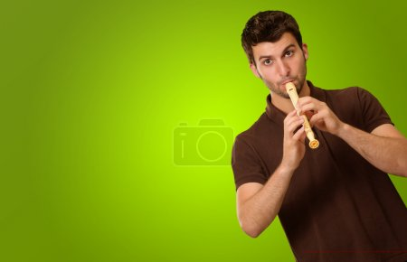 Portrait Of A Young Man Playing Flute