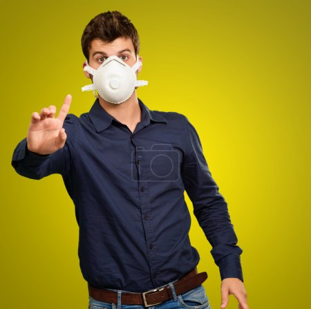 Young Man Gesturing And Wearing Mask
