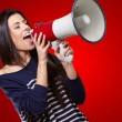 Portrait Of A Female With Megaphone On Red Backgro...