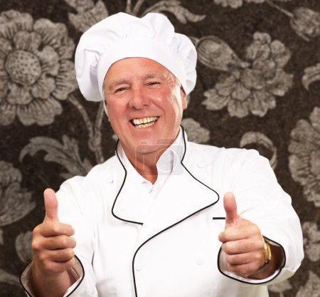 Portrait Of A Chef Cook With Hand Sign