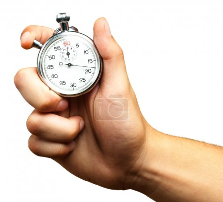 Photo for Close Up Of Hand Holding Stopwatch On White Background - Royalty Free Image
