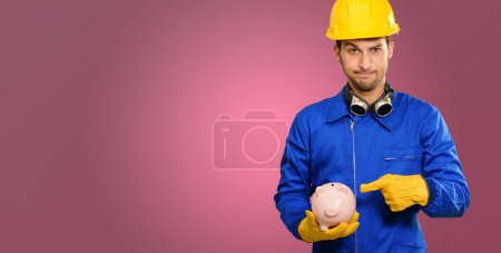 Engineer Holding Piggy Bank