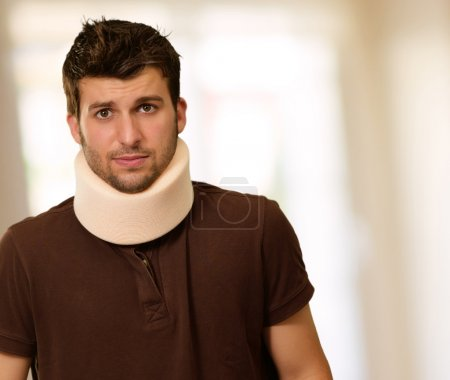 Photo for Young Man With Neck Brace, Indoor - Royalty Free Image
