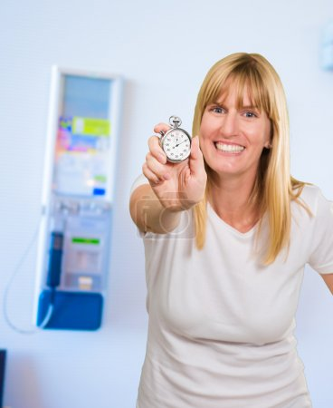 Woman Holding Stopwatch