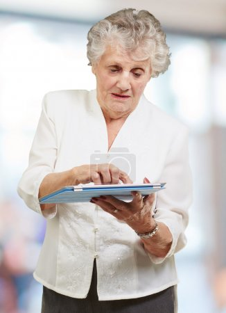 Senior woman using ipad