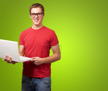 Photo for Happy man holding laptop isolated on green background - Royalty Free Image