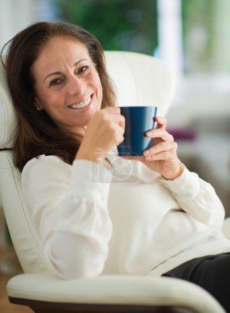 Happy Mature Woman Drinking Coffee