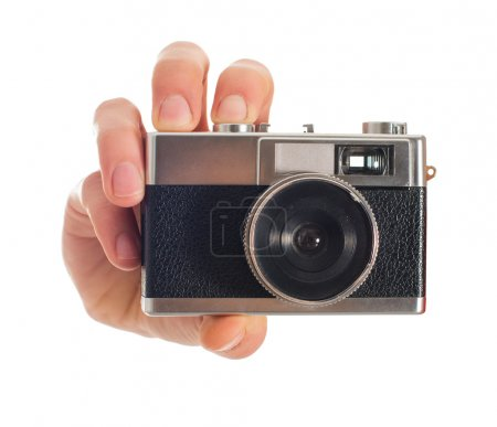 Human Hand Holding Camera
