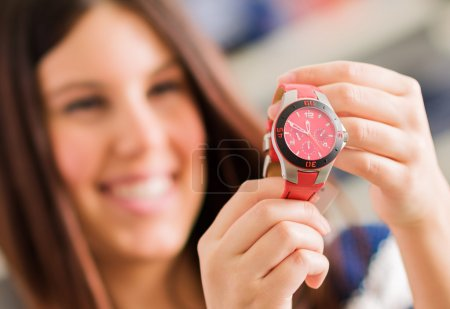 Photo for Happy Woman Buying New Wristwatch, Indoors - Royalty Free Image