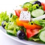 Fresh vegetable salad isolated on white background...