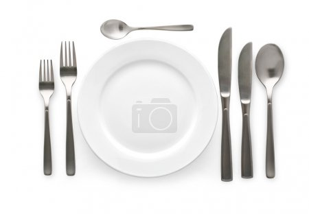 Photo for Place setting with plate, knife and fork. on white background - Royalty Free Image