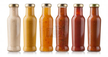Photo for The various barbecue sauces in glass bottles - Royalty Free Image