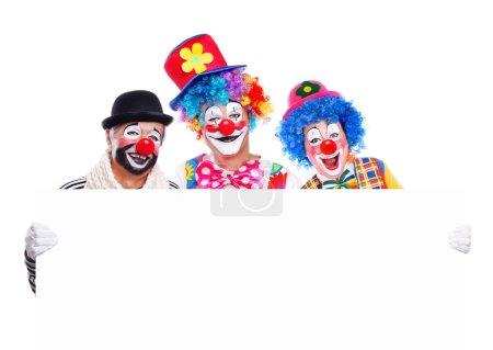 Three birthday clowns