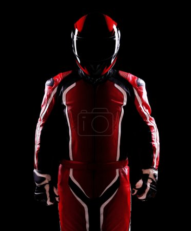 Photo for Low key silhouette of a biker holding helmet on black background - Royalty Free Image