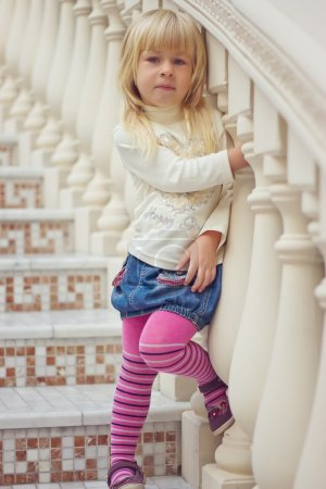 Girl 3 years old tights is a beautiful staircase