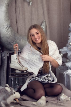 Girl surrounded by Christmas paraphernalia