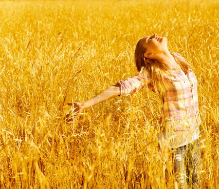 Happy woman on wheat field
