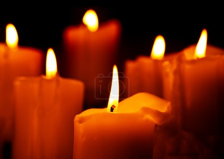 Photo of candle isolated on black background, roma...