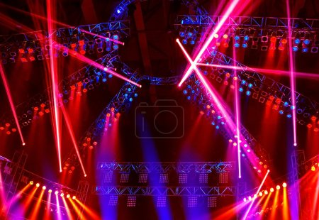 Photo for Image of nightclub lights, red spotlight beam in the dance club, Christmas celebration, clubbing life, colorful festive rays on the stage on concert, New Year party, laser performance, holiday concept - Royalty Free Image