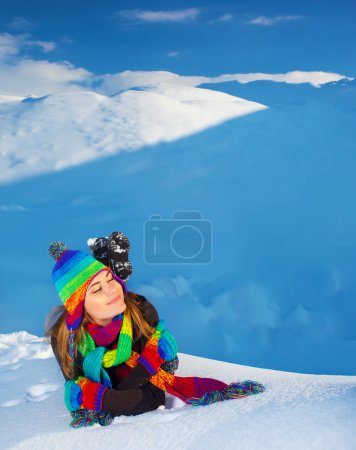 Woman in snowy mountains