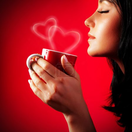 Photo for Beautiful lady drinking coffee, brunette enjoy cup of hot chocolate, side view cute girl isolated on red background, portrait of female with morning tea, gorgeous woman holding cappuccino mug - Royalty Free Image
