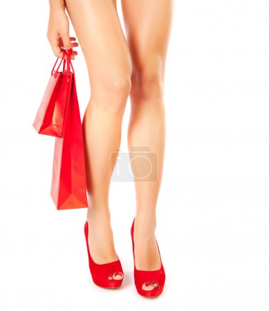 Woman in red shoes with gift