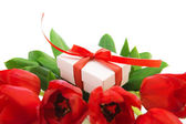 Red tulips and white gift box