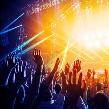 Photo for People enjoying rock concert , crowd with raised up hands dancing in nightclub, audience applauding to musician band - Royalty Free Image