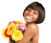 Smiling black girl with bouquet