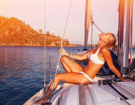 Sexy woman tanning on yacht