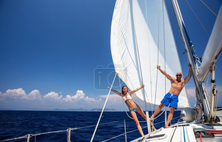 Happy couple on sailboat