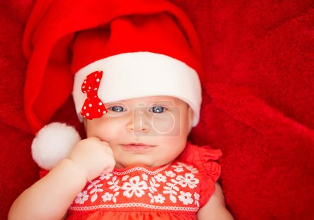 Newborn girl wear Santa hat