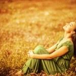 Romantic woman wearing long elegant dress sitting ...