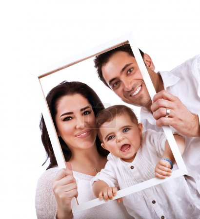 Photo for Happy family portrait isolated on white background, holding in hands frame, nice picture of adorable baby girl with parents - Royalty Free Image