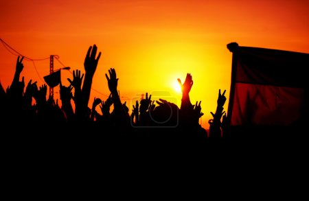 Photo for Revolution, people protest against government, man fighting for rights, silhouettes of hands up in the sky, threat of war - Royalty Free Image