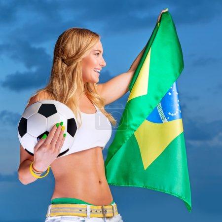 Happy fan of Brazilian football team