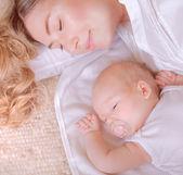 Little baby with mother sleep