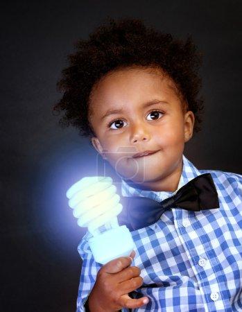 Little genius with illuminated lamp