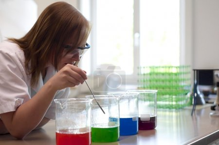 Female college student experimenting in a laboratory