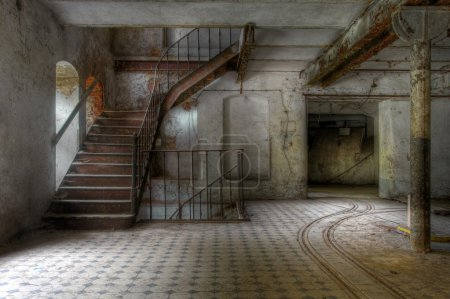 Photo for Old staircase in an abandoned factory and tracks - Royalty Free Image