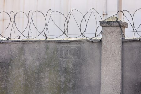 concrete walls with barbed wire for above