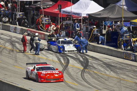 Corvette passes Ford Can-Am in pit stop at Grand AM Rolex Races on Mazda Laguna Seca Raceway