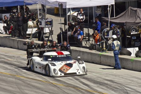 Ford Can-Am leaving pit stop at Grand AM Rolex Races on Mazda Laguna Seca Raceway