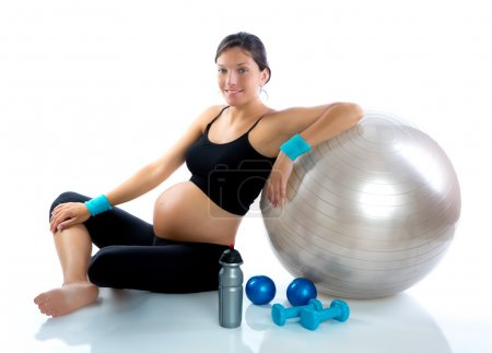 Photo for Beautiful pregnant woman at fitness gym relaxed with aerobics ball - Royalty Free Image