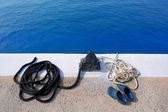 Boat noray marine rope and shoes in marina